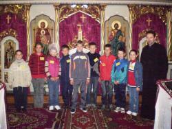View The Hristos împărtăşit copiilor Album